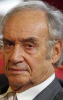 Андре Умански