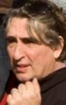 Том Эрисман